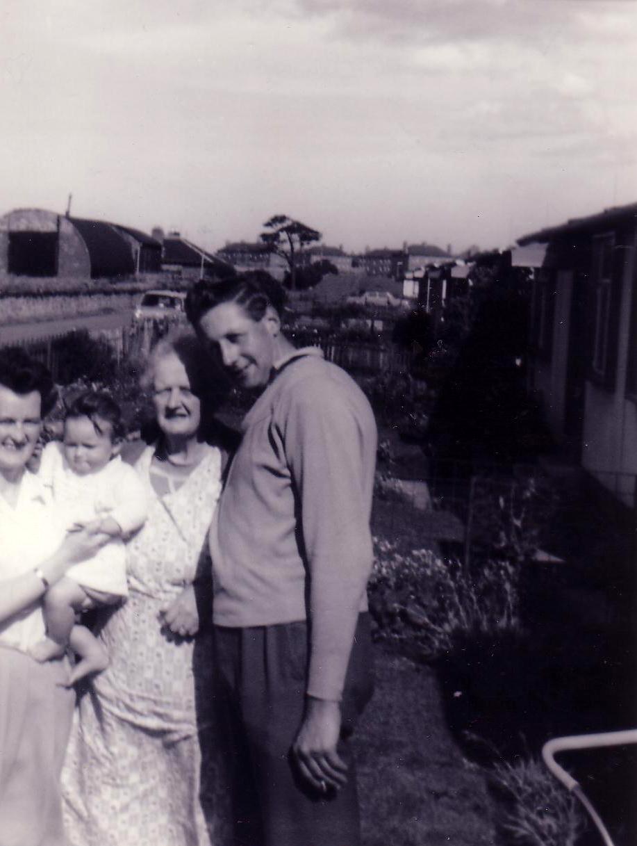 Family Standing In Garden Outside Prefab Home 1950s