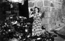'Drunk' Woman In Street Among Pile Of Bottles 1950s