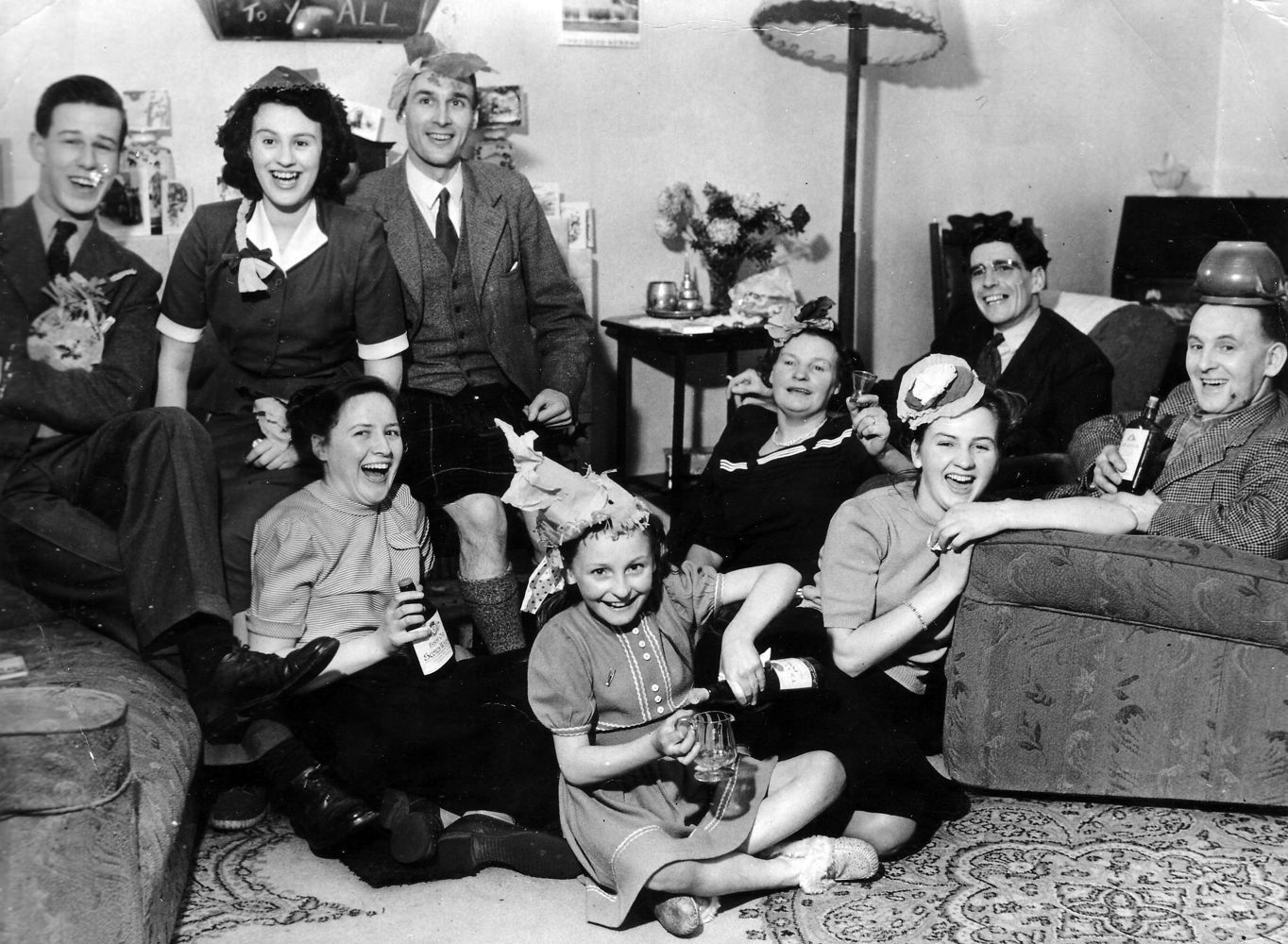 Family And Friends In Sitting Room Seeing In The New Year 1950s