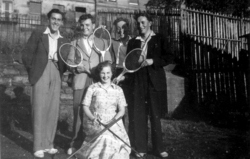 Four Men And Woman Posing With Sporting Equipment 1950s