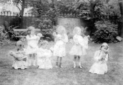Young Girls Playing With Dolls In the Garden c.1910
