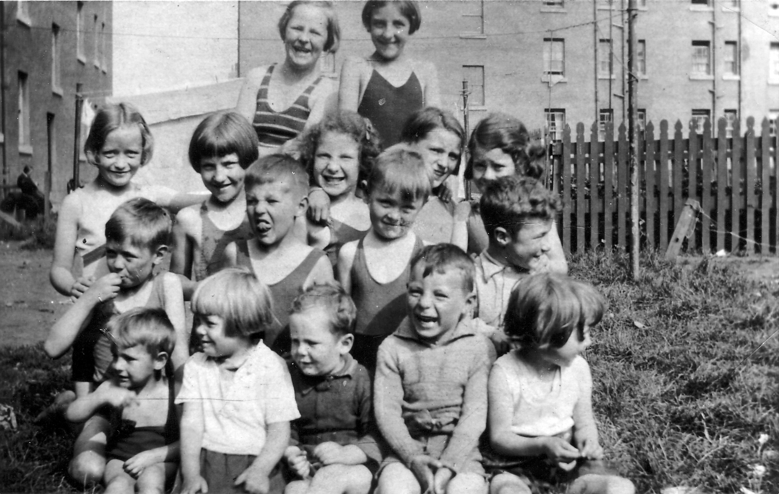 Group Of Children Playing In Back Green 1930s