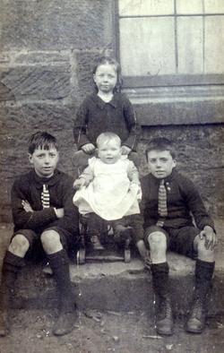 Children Sitting Outside On The Street 1920s