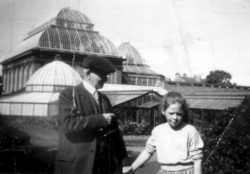 Man And Girl Standing In Front Of The Palm House At The Botanic Gardens 1950s