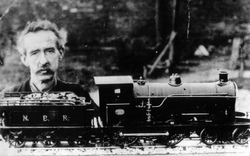 Man Posing With His Self-Built Model Train 1940s