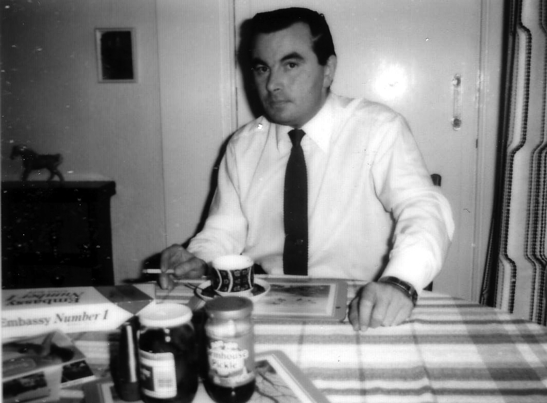 Man Having Cup Of Tea And Cigarette At Dinner Table 1960s