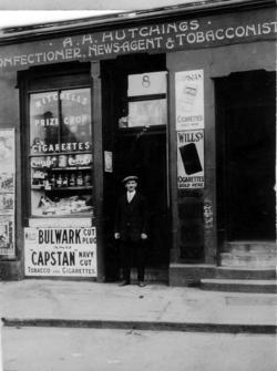 Man Standing In Doorway Of Newsagent Shop c.1920