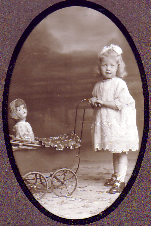 Studio Portrait Girl Pushing Doll In Pram 1920s