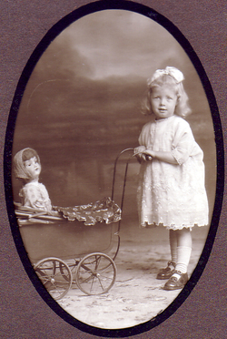 Studio Portrait Girl With Pram And Doll 1920s