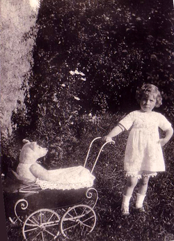 Girl Pushing Teddy Bear In Pram 1930s