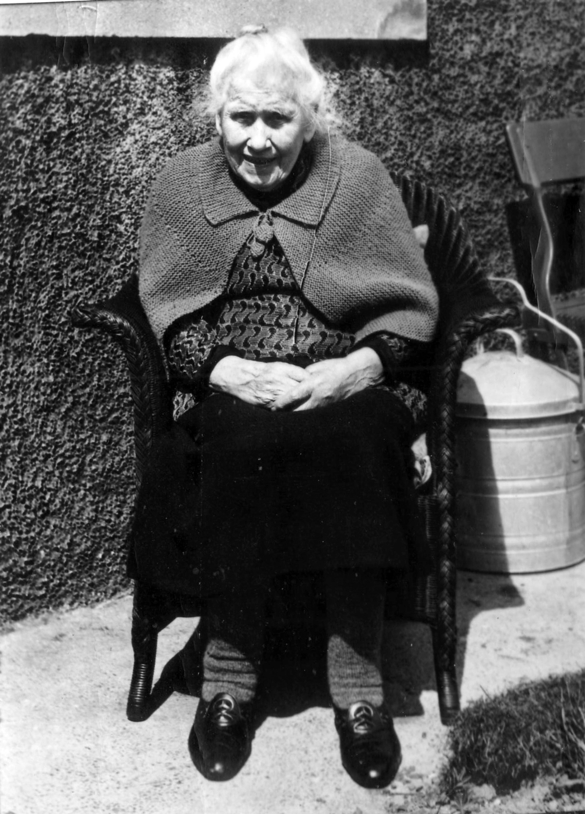 Elderly Woman Sitting Outside Her Home 1960s