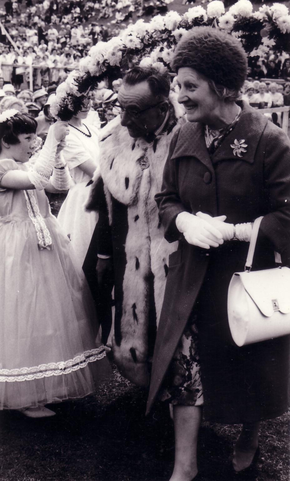 Mayor And Lady Walking Under Garland 1940s