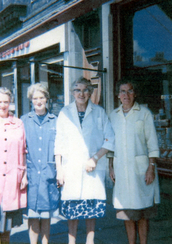 Four Shop Assistants Standing Under Shop Awning 1960s