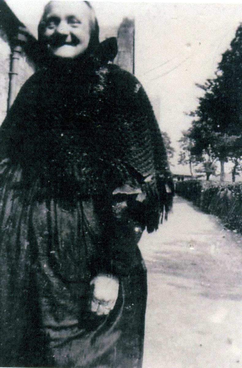 Elderly Woman In Black Standing In Street 1930s