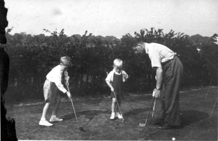 Man And Two Boys Putting On The Green 1950s