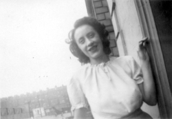 Close-Up Lady Standing By Doorway, early 1950s