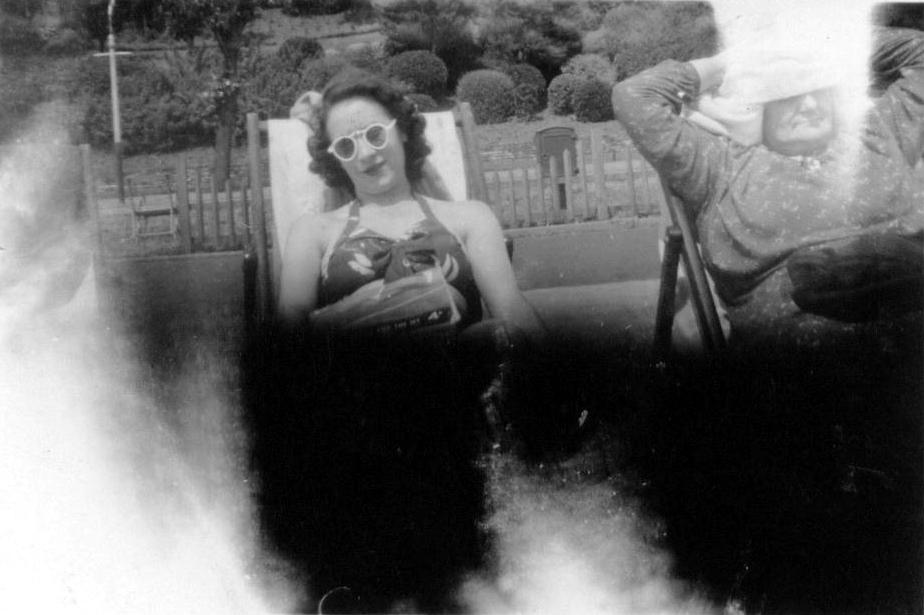 Two Women Sunbathing On Deckchairs 1950s