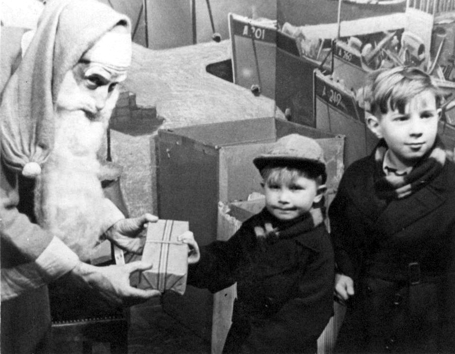 Boy Receiving Present From Department Store Santa c.1960