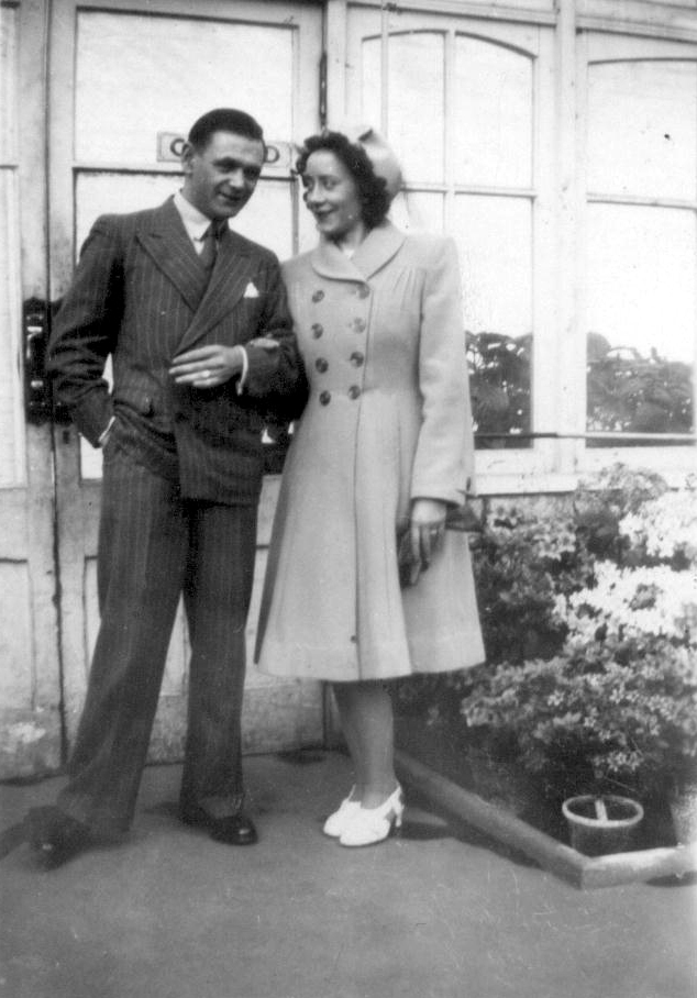 Couple Standing At Entrance To Botanic Gardens Glasshouse, early 1950s