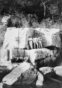 Group Of Men Resting In Rock Formation By River 1910s