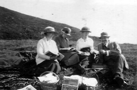 Outdoor Group Enjoying Picnic 1920s