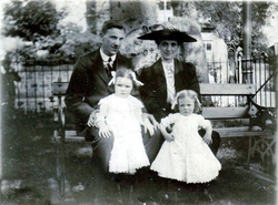 Young Couple With Children Sitting On Park Bench c.1912