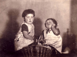 Two Young Girls Sitting In Basket 1910s