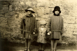 Three Children Dressed Up In Hat and Coat 1930s