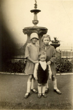 Three Children Standing In Front Of The Devlin Fountain At Starbank Park 1930s
