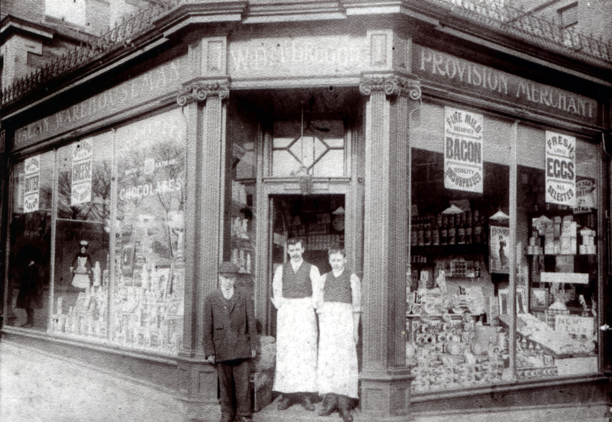 Shopkeepers Standing In Doorway Of Grocery Store 1910s