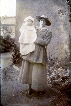 Edwardian Lady Carrying Young Child 1910s