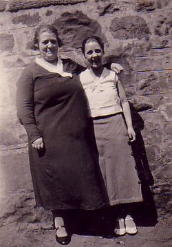 Woman And Girl Standing By Wall 1930s