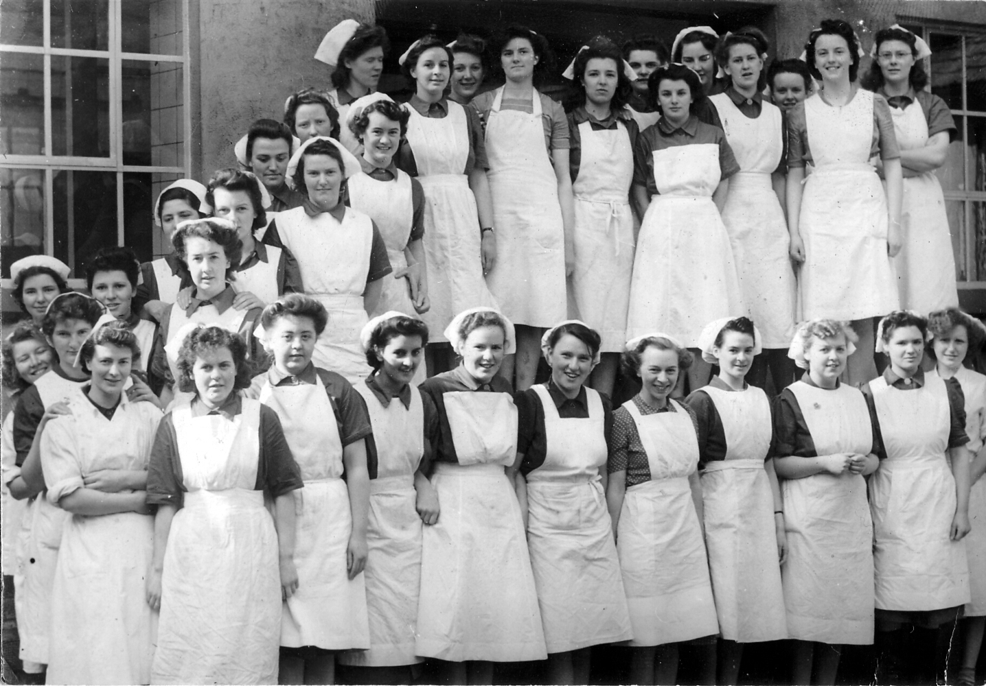 Dairy Workers Standing Outside Dairy Building, late 1940s