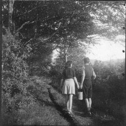 Boy And Girl Carrying Pail Along Path, late 1940s