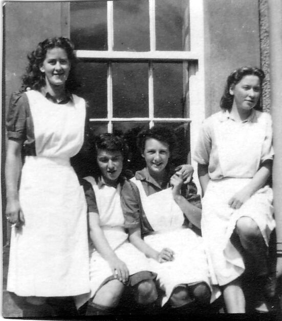 Young Dairy Workers Sitting By Window, late 1940s
