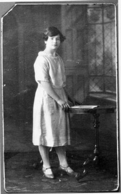 Studio Portrait Young Woman Standing By Table 1930s