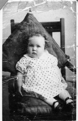 Studio Portrait Baby Girl Sitting Upright In Chair 1930s