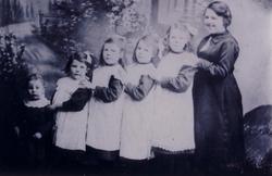 Studio Portrait Family Standing In Line 1900s