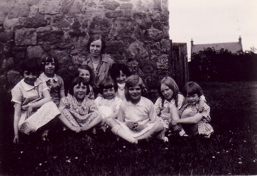 Woman With Group Of Girls Sitting Outside A Building 1930s