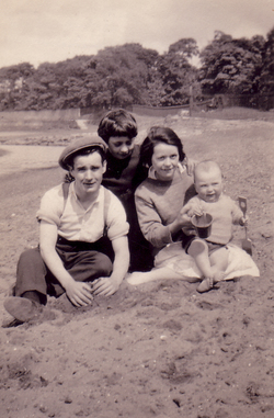 Young Family Playing On The Beach 1930s