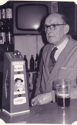 Barman With Pint Behind The Bar c.1970
