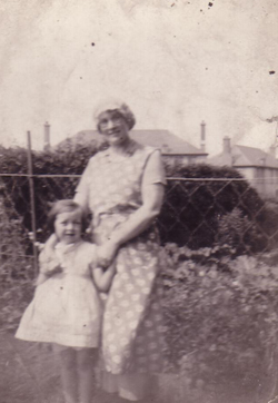 Woman With Girl In The Back Garden, late 1930s