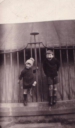 Boy And Girl Standing By Park Railings 1930s