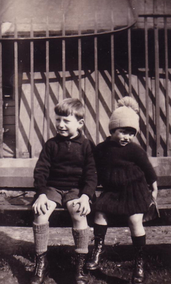 Boy And Girl Sitting On Park Bench By Railings 1930s
