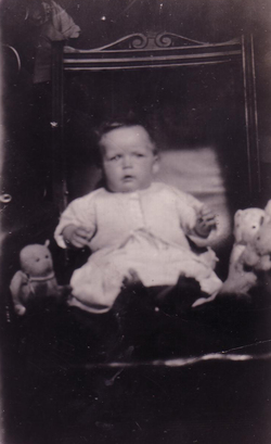Young Child Sitting In Chair With Soft Toys c.1930