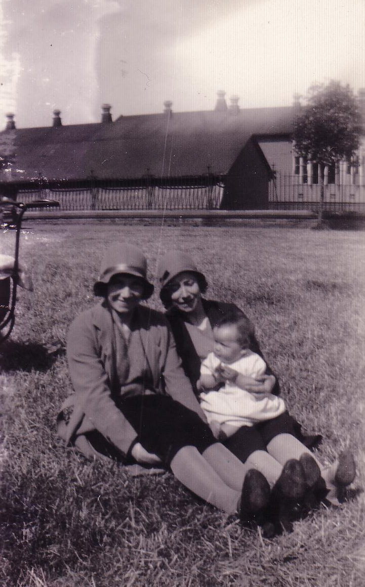 Two Women And Young Child Sitting In Park 1930s