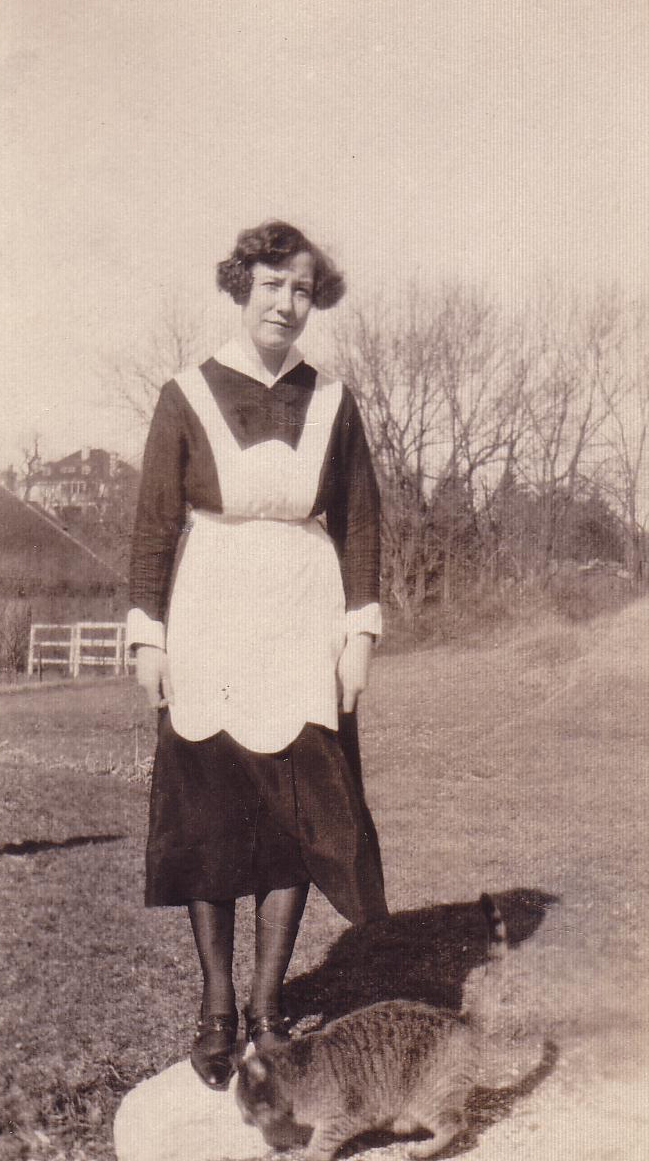 Maid Standing In Field With Cat At Feet 1930s
