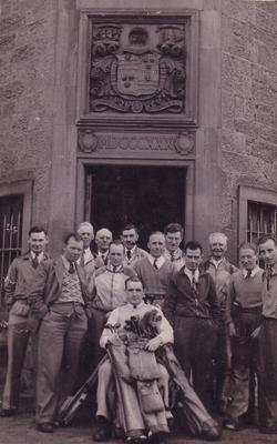 Group Of Golfers Standing In Doorway Under Coat Of Arms 1940s