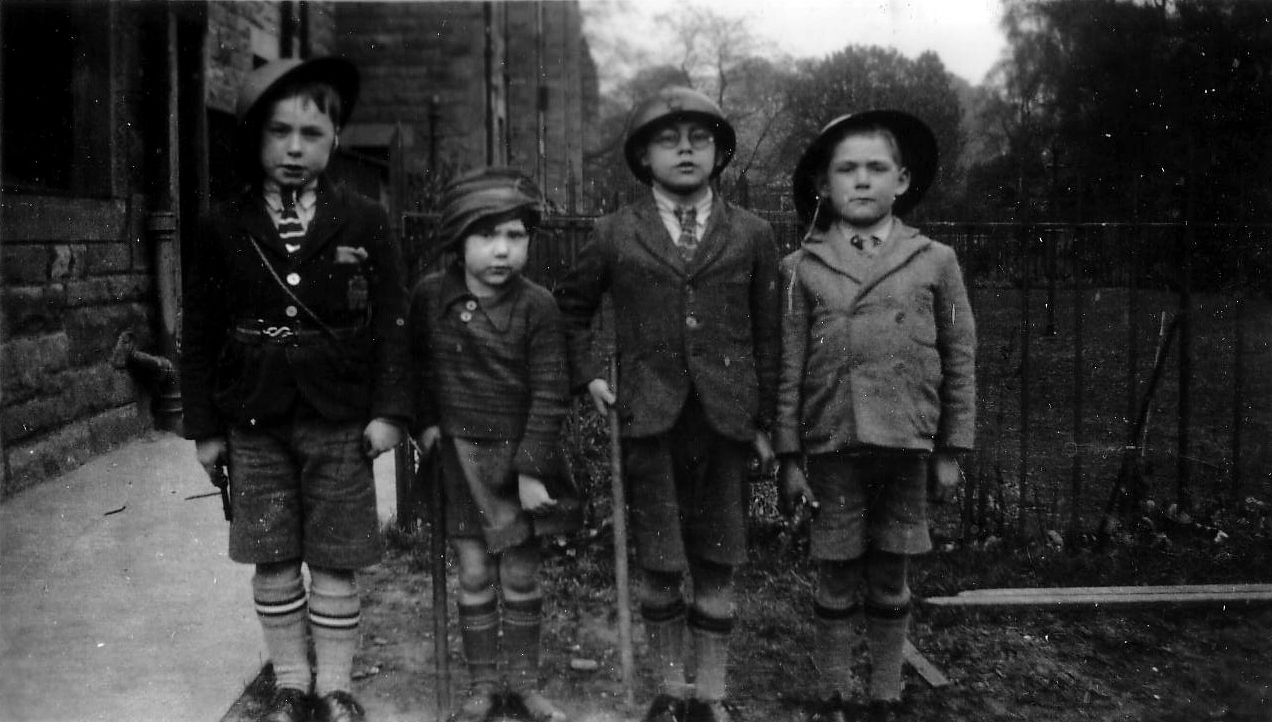 Three Schoolboys And Young Girl Playing At Being Soldiers Standing To Attention 1930s