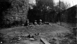 Three Schoolboys In Hole In Garden Playing At Being Soldiers 1930s